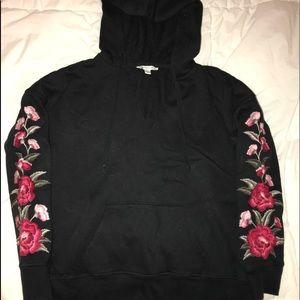 American Eagle black hoodie with roses on sleeves